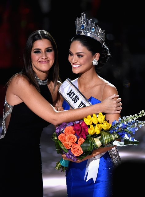 Miss Philippines 2015, Pia Alonzo Wurtzbach (R), reacts as she is crowned the 2015 Miss Universe by 2014 Miss Universe Paulina Vega (L) during the 2015 Miss Universe Pageant at The Axis at Planet Hollywood Resort & Casino on December 20, 2015 in Las Vegas, Nevada. Miss Colombia 2015, Ariadna Gutierrez (not pictured), was mistakenly named as Miss Universe 2015 instead of First Runner-up. (Photo by Ethan Miller/Getty Images)