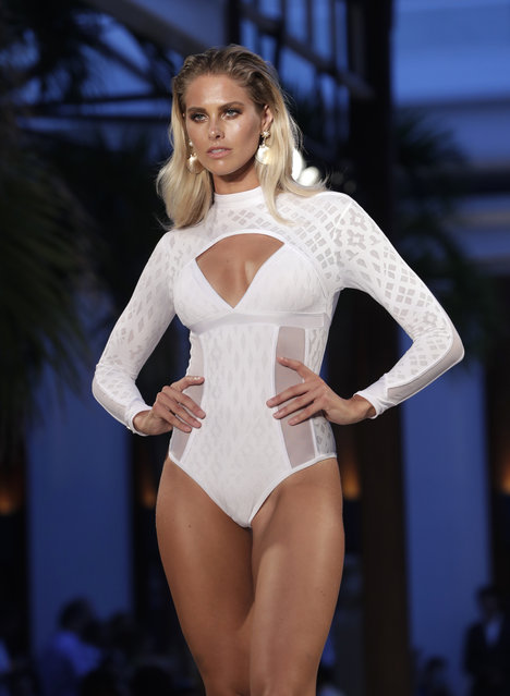 A model walks down the runway during the Fashion Palette Miami Australian Swim Show during Miami Swim Week, Sunday, July 15, 2018, in Miami Beach, Fla. (Photo by Lynne Sladky/AP Photo)