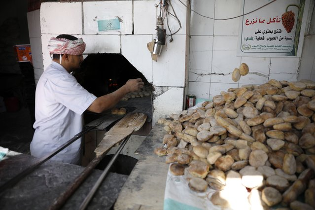 A Yemeni worker prepares bread for sale at a bakery in Sana?a, Yemen, 13 December 2020. According to reports, the UN relief groups have warned that five million people in Yemen are poised to face food insecurity in the first half of 2021 placing more millions on the brink of famine. Nearly 80 percent of war-ridden Yemen's 29 million-population rely on humanitarian aid. (Photo by Yahya Arhab/EPA/EFE)