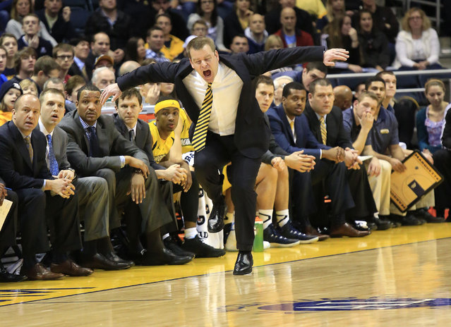 Marquette head coach Steve Wojciechowski reacts as his team takes on Butler during the first half of an NCAA college basketball game, Saturday, January 31, 2015, in Milwaukee. (Photo by Darren Hauck/AP Photo)