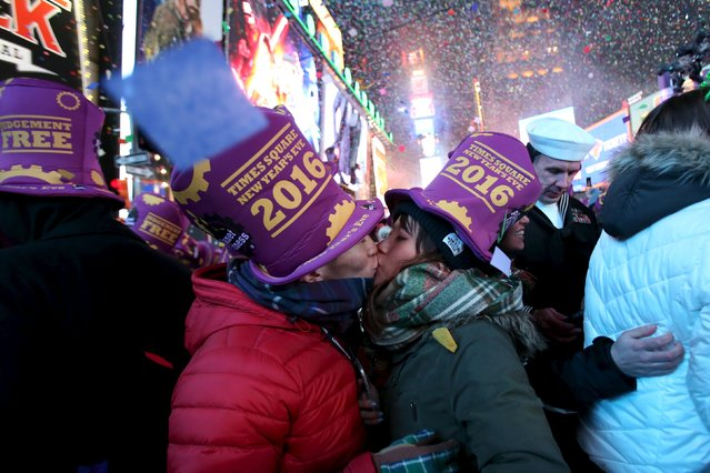 Takanobu Nobori and Shoko Toyama kiss during New Year celebrations in Times Square in the Manhattan borough of New York January 1, 2016. (Photo by Andrew Kelly/Reuters)