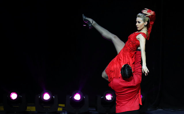 Juan Francisco Segui and Maira Daiana Sanchez, representing the city of Avellaneda, Argentina, perform during the Stage style final round at the Tango World Championship in Buenos Aires, Argentina on August 23, 2018. (Photo by Marcos Brindicci/Reuters)