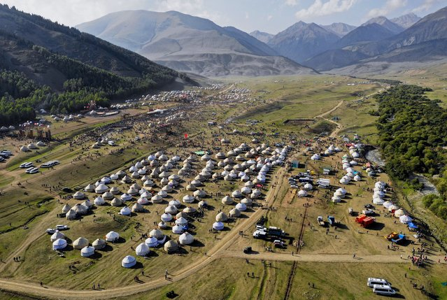 The yurt city nestled in the bowl-shaped valley of Kyrchyn Gorge, the second, and most spectacular, venue of the 2018 Nomad Games. (Photo by Amos Chapple/Radio Free Europe/Radio Liberty)