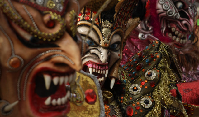 Revelers wearing devil masks dance in the street during Carnival celebrations in Panama City, Monday, February 16, 2015. (Photo by Arnulfo Franco/AP Photo)
