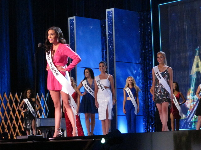 """Miss West Virginia Madeline Collins introduces herself during the third and final night of preliminary competition in the Miss America pageant in Atlantic City N.J. on Friday September 7, 2018. Later in the night, during her onstage interview, Collins said President Trump """"has created a lot of division in this country"""". (Photo by Wayne Parry/AP Photo)"""