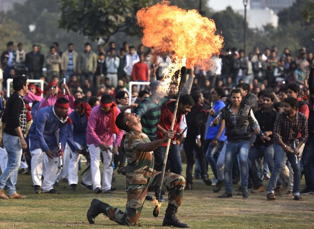 Indian Army Soldiers perform stunts and display their skills during a performnace in public in the wake of Indian Army Day at Central Park, Connaught Place on January 10, 2016 in New Delhi, India. (Photo by Raj K Raj/Hindustan Times via Getty Images)