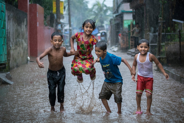 Happiness on a Rainy Day by Fardin Oyan, Bangladesh. Winner of the young environmental photographer of the year. Many children in Bangladesh love to bathe and play in the rain. The country, which is flat and occupied by the huge Ganges-Brahmaputra Delta, is exposed to floods, especially during monsoon season. (Photo by Fardin Oyan/2018 Ciwem environmental photographer of the year 2018)