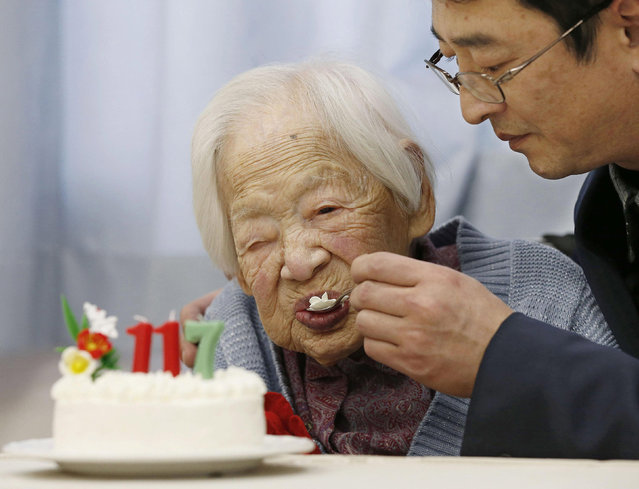 Japanese Misao Okawa, the world's oldest living person, is helped to eat her birthday cake as she celebrates her 117th birthday at an elder care facility in Osaka, western Japan in this photo taken by Kyodo March 5, 2015. Okawa celebrated her 117th birthday on Thursday.  Mandatory Credit REUTERS/Kyodo