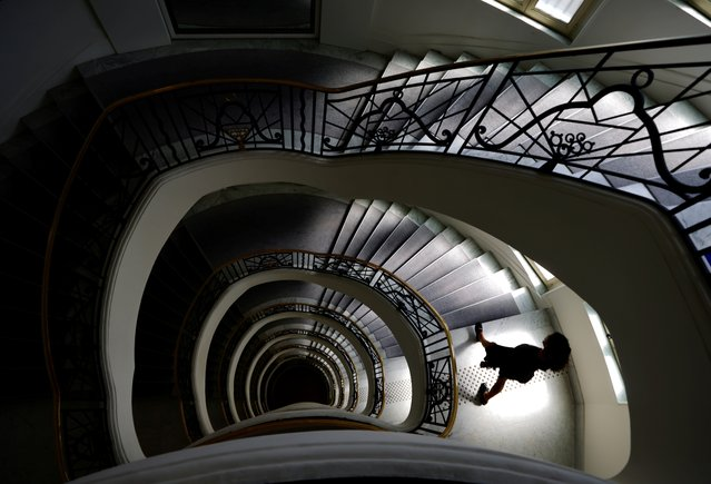A woman walks in the stairs of the Hotel Martinez in Cannes as the French Riviera prepares for the 2021 edition of the Cannes Film Festival which will take place next July, in France, June 3, 2021. (Photo by Eric Gaillard/Reuters)