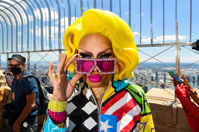 """Cast member Yara Sophia of """"RuPaul's Drag Race"""" visits the Empire State Building in New York City on June 24, 2021. (Photo by Stephen Lovekin/Rex Features/Shutterstock)"""