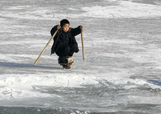 A North Korean boy skates on the ice of the Yalu River at the border to China near the North Korean city of Hyesan December 1, 2008. (Photo by Reinhard Krause/Reuters)