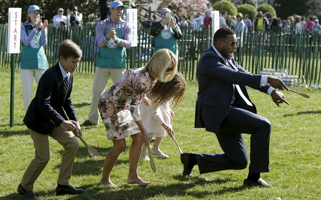Morning talk show hosts Kelly Ripa (C) and Michael Strahan (R) participate in the annual White House Easter Egg Roll in Washington April 6, 2015. (Photo by Gary Cameron/Reuters)