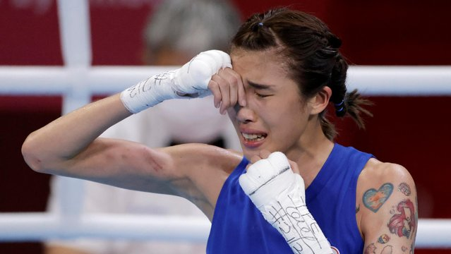 Chinese Taipei's Hsiao-Wen Huang reacts after winning her fight against Serbia's Nina Radovanovic during their women's fly (48-51kg) quarter-final boxing match during the Tokyo 2020 Olympic Games at the Kokugikan Arena in Tokyo on August 1, 2021. (Photo by Ueslei Marcelino/Reuters)