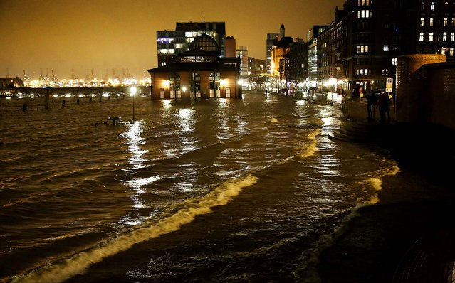 The famous landmark fish market in the harbor of Hamburg is flooded as Storm Xaver approaches the coast of Germany, on December 5, 2013. (Photo by Morris Mac Matzen/Reuters)