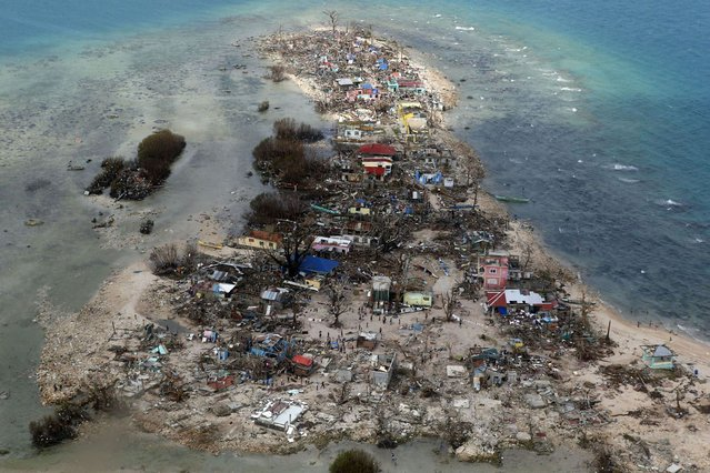 An aerial view of a coastal town, devastated by super Typhoon Haiyan, in Samar province in central Philippines November 11, 2013. (Photo by Maxim Zmeyev/Reuters)