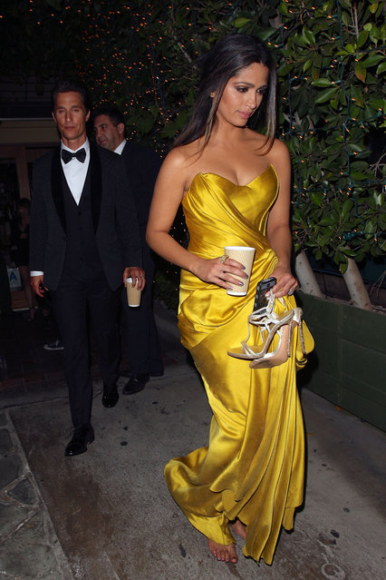 """Following his big win at the 20th SAG Awards for """"Outstanding Performance by a Male Actor in a Leading Role"""", Matthew McConaughey and Camila Alves have dinner at Ago restaurant in West Hollywood. As they walk to their car Alves opts to go barefoot as she carries her strappy high heels. (Photo by Zavar/Raffi/NPG.com)"""