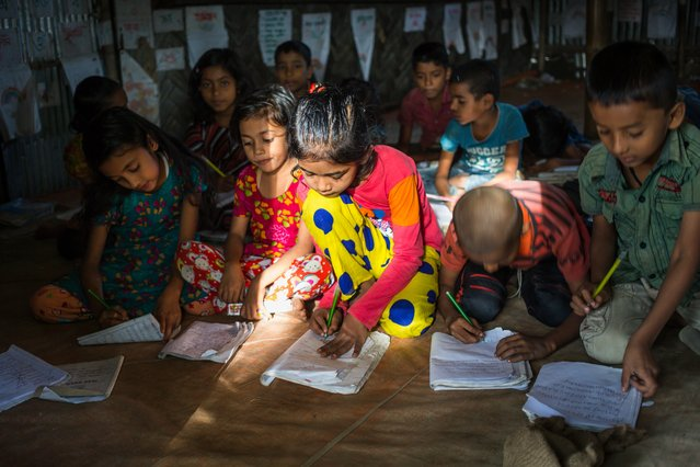 Children learning English at the school in Kutubdia para, or neighbourhood, Cox's Bazar. Many villagers are migrants who fled nearby Kutubdia island after they lost their lands when a cyclone hit in 1991. (Photo by Noor Alam/Majority World)