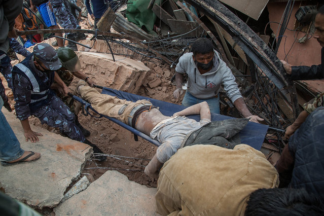 Emergency rescue workers carry a victim on a stretcher after Dharara tower collapsed on April 25, 2015 in Kathmandu, Nepal. (Photo by Omar Havana/Getty Images)