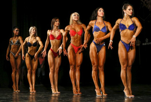 Participants pose during a local bodybuilding and fitness championship in the Siberian city of Krasnoyarsk, Russia, March 5, 2016. (Photo by Ilya Naymushin/Reuters)