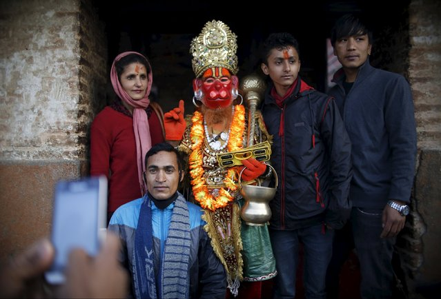 A Hindu holy man, or sadhu, poses for a picture along with devotees during the Shivaratri festival at the premises of Pashupatinath Temple in Kathmandu, Nepal, March 7, 2016. (Photo by Navesh Chitrakar/Reuters)