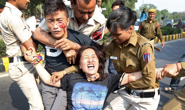 Indian police detain Tibetan activists during a protest held to mark the 57th anniversary of the Tibetan uprising against Chinese rule, outside the Chinese embassy in New Delhi, India, March 10, 2016. (Photo by Cathal McNaughton/Reuters)