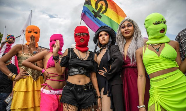 """Members of the Feminist Liberation Front pose for a photo during a rally on October 9, 2021 in Bangkok, Thailand. The Feminist's Liberation Front is a democratic reform group focused on promoting gender equality and LGBTQ rights in Thailand. While raising awareness of issues such as marriage equality, gender-based violence, and oppression, the speakers at rally's organized by the Feminist Liberation Front also call for institutional reform and the repeal of Section 112, a criminal code in Thailand's lese majeste laws which carry up to 15 years in prison. Under the leadership of Chumaporn """"Waaddao"""" Taengkliang, the Feminist Liberation Front acts as a safe space for feminists, members of the LGBTQ community, activists and allies while maintaining peaceful, colorful protests promoting inclusivity and human rights. While globally Thailand is considered an inclusive country for LGBTQ+ communities and tourists, those living here struggle for equal rights as courts continue to postpone rulings in a groundbreaking LGBTQ+ marriage equality case. (Photo by Lauren DeCicca/Getty Images)"""