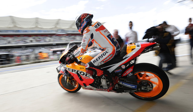 Marc Marquez (93), of Spain, speeds out of the garage after a pit stop during a final practice session for the Grand Prix of the Americas motorcycle race at the Circuit Of The Americas, Saturday, April 13, 2019, in Austin, Texas. (Photo by Eric Gay/AP Photo)