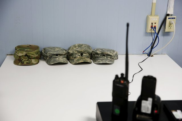 Soldiers' hats rest on a table next to radios in Joint Task Force Guantanamo's detainee hospital at the U.S. Naval Base in Guantanamo Bay, Cuba March 22, 2016. (Photo by Lucas Jackson/Reuters)