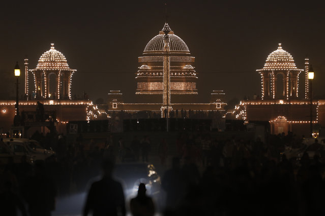 "India's Presidential Palace is illuminated during the ""Beating the Retreat"" ceremony in New Delhi January 29, 2013. (Photo by Adnan Abidi/Reuters)"