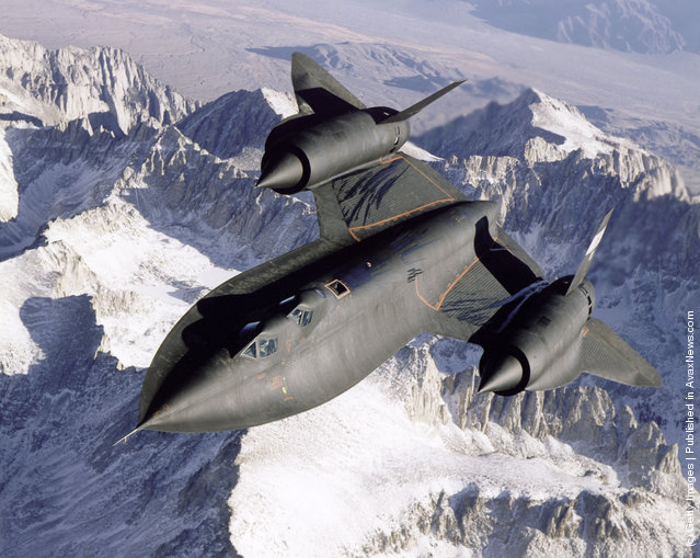 SR-71B Blackbird aerial reconnaissance aircraft photographed over snow capped mountains in 1995