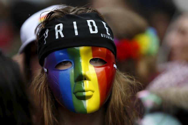 A participant wears a rainbow mask as she attends the Belgian lesbian, gay, bisexual and transgender (LGBT) Pride Parade in Brussels, Belgium, May 16, 2015. (Photo by Francois Lenoir/Reuters)