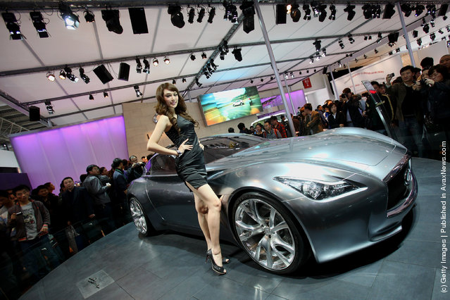A model stands beside a Infiniti Essence