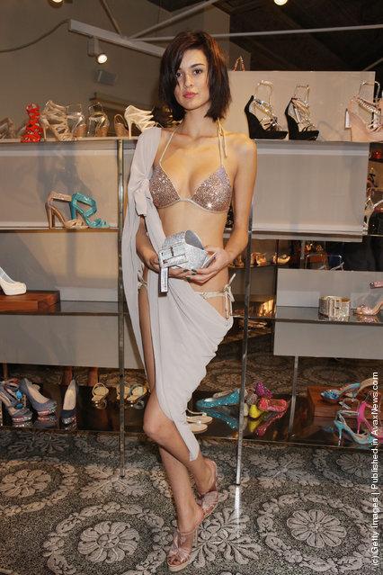 A model poses at the Le Silla Spring/Summer 2012 presentation as part Milan Womenswear Fashion Week