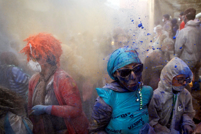 """Revellers celebrate """"Ash Monday"""" by participating in a colourful """"flour war"""", a traditional festivity marking the end of the carnival season and the start of the 40-day Lent period until the Orthodox Easter,in the port town of Galaxidi, Greece, February 27, 2017. (Photo by Alkis Konstantinidis/Reuters)"""