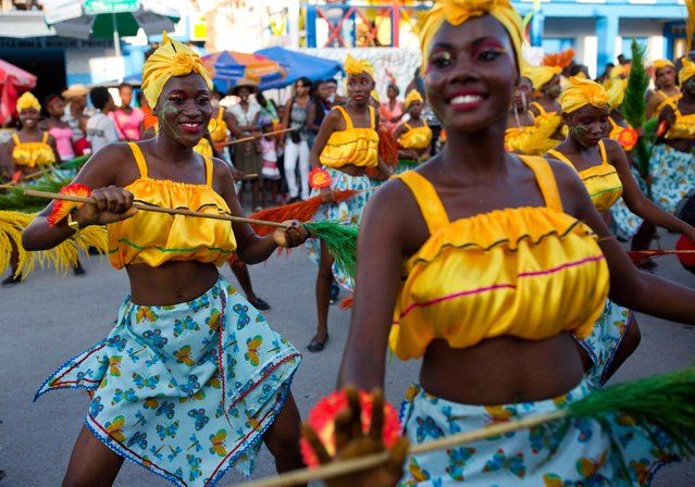 Dancers perform at a Carnival parade in Les Cayes, Haiti, Tuesday, February 28, 2017. (Photo by Dieu Nalio Chery/AP Photo)