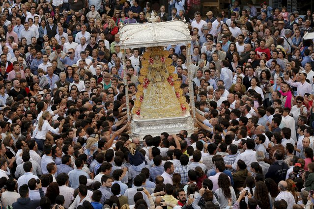 Pilgrims crowd around the Virgin of El Rocio during a procession around the shrine of El Rocio in Almonte, southern Spain, May 25, 2015. (Photo by Marcelo del Pozo/Reuters)