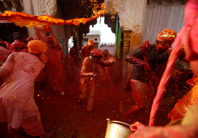 Hindu devotees take part in the religious festival of Holi in Nandgaon village, in the state of Uttar Pradesh, India, March 7, 2017. (Photo by Adnan Abidi/Reuters)