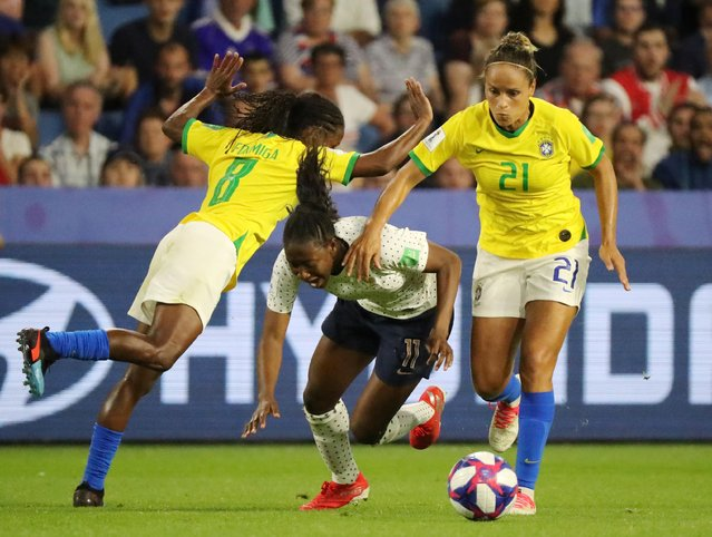 France's forward Kadidiatou Diani (C) vies with Brazil's midfielder Formiga (L) and Brazil's defender Monica during the France 2019 Women's World Cup round of sixteen football match between France and Brazil, on June 23, 2019, at the Oceane stadium in Le Havre, north western France. (Photo by Lucy Nicholson/Reuters)