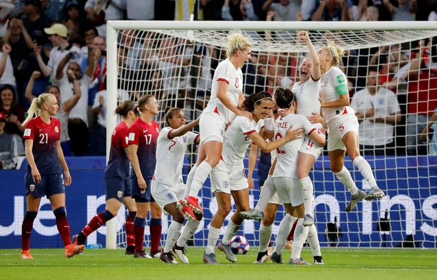 England players celebrate their third goal during the 2019 FIFA Women's World Cup France Quarter Final match between Norway and England at Stade Oceane on June 27, 2019 in Le Havre, France. England won the match 3-0. (Photo by Bernadett Szabo/Reuters)