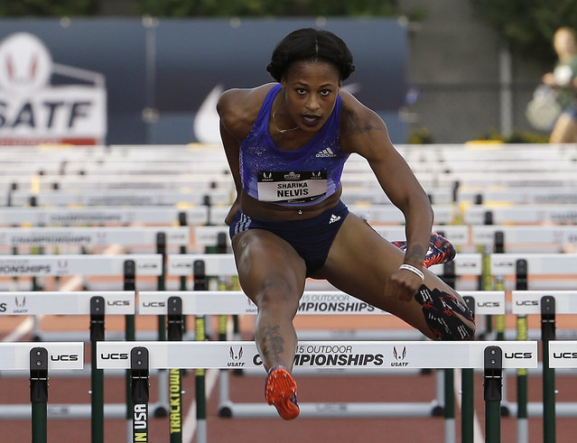 Sharika Nelvis clears the last hurdle to win her semifinal heat of the 100 hurdles at the U.S. track and field championships in Eugene, Ore., Friday, June 26, 2015. (Photo by Don Ryan/AP Photo)