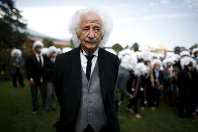 Benny Wasserman, 81, stands with other people dressed as Albert Einstein as they gather to establish a Guinness world record for the largest Einstein gathering, to raise money for School on Wheels and homeless children's education, in Los Angeles, California, United States, June 27, 2015. (Photo by Lucy Nicholson/Reuters)