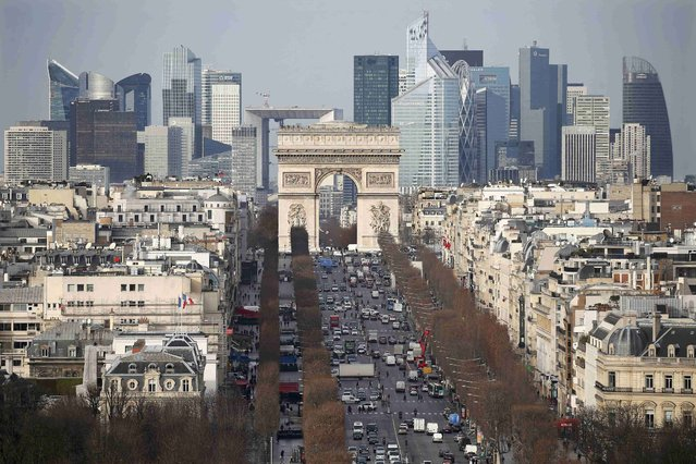 General view of the skyline of La Defense business district with its Arche behind Paris' landmark, the Arc de Triomphe and the Champs Elysees Avenue in Paris, France, Janury 13, 2016. (Photo by Charles Platiau/Reuters)