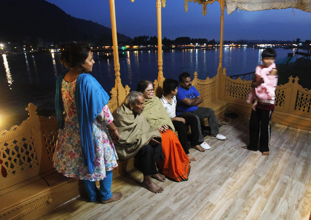 Indian tourists enjoy an evening on the deck of a houseboat in Srinagar June 8, 2012. (Photo by Fayaz Kabli/Reuters)