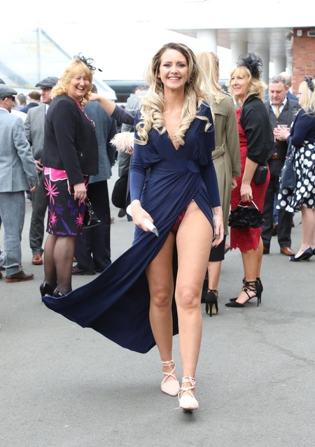 A blonde risked an embarrassing wardrobe blunder thanks to her daringly high-cut slit dress during the Grand National Festival at Aintree Racecourse on April 7, 2017 in Liverpool, England. (Photo by WENN)