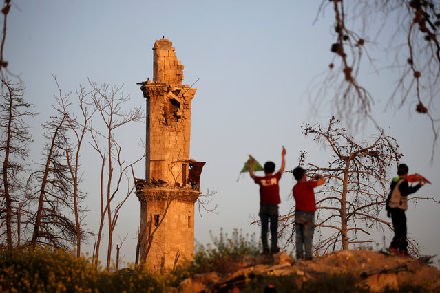 Boys play near the 14th century Tawashi Mosque with a damaged minaret, in the old city of Aleppo, Syria April 12, 2019. (Photo by Omar Sanadiki/Reuters)
