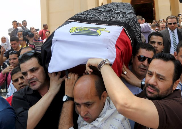 "Mourners carry the coffin of Egyptian actor Omar Sharif during a funeral procession at the Field Marshal Mohammed Hussein Tantawi Mosque in Cairo, Egypt, July 12, 2015. Sharif, best known for his portrayal of Doctor Zhivago in the hit 1966 film and for his work in ""Lawrence of Arabia"", died of a heart attack on Friday, his agent said. He was 83. (Photo by Mohamed Abd El Ghany/Reuters)"