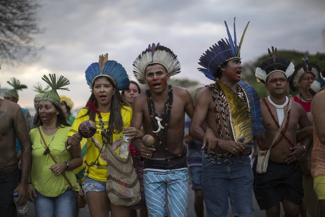 Indigenous supporters of Dilma Rousseff march to Congress in Brasilia, Brazil, Wednesday, May 11, 2016. On Thursday, President Dilma Rousseff was impeached on allegations she violated fiscal laws. (Photo by Felipe Dana/AP Photo)