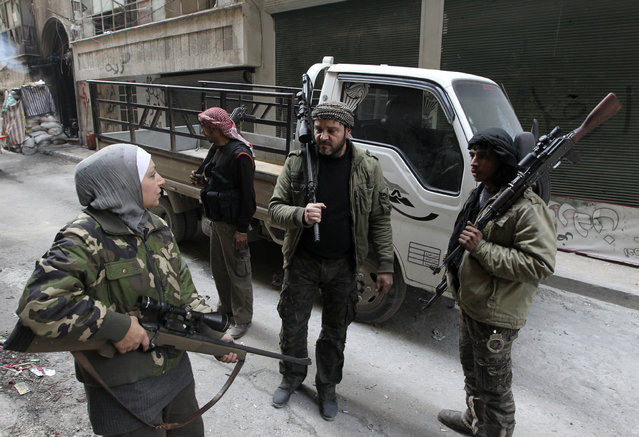 Guevara (L), a Syrian Palestinian woman married to an Al Wa'ad battalion commander, is pictured in Aleppo January 19, 2013. (Photo by Muzaffar Salman/Reuters)