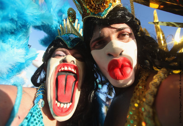 Brazilian revelers pose during Carnival celebrations along Ipanema beach in Rio de Janiero