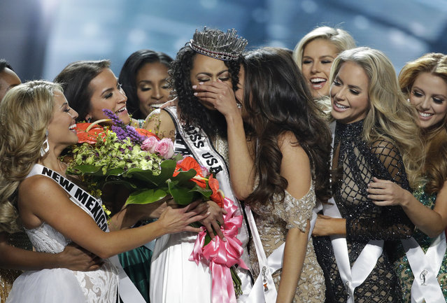 Miss District of Columbia USA Kara McCullough, center, reacts with fellow contestants after she was crowned the new Miss USA during the Miss USA contest Sunday, May 14, 2017, in Las Vegas. (Photo by John Locher/AP Photo)